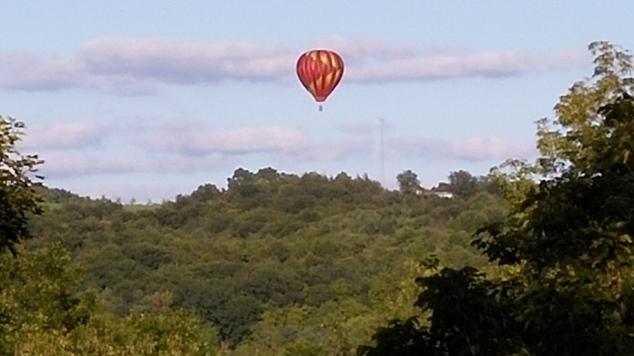 balloon-over-hills